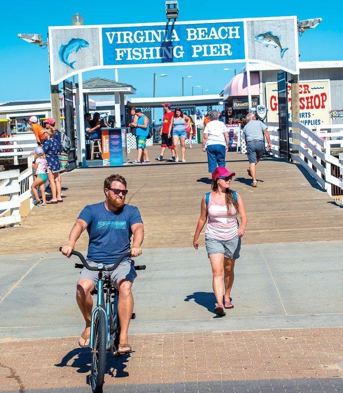 guy on bicycle at the virginia beach fishing pier